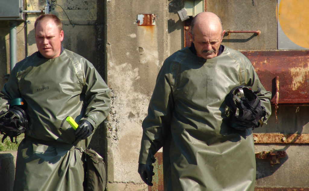 Men in protective suits